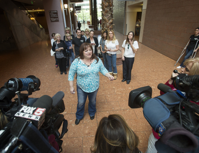 Gina Greisen with Nevada Voters for Animals speaks after the puppy restraining order hearing at Regional Justice Center,Wednesday, March 19, 2014. District Court Judge Kenneth C. Cory's  rebuked l ...