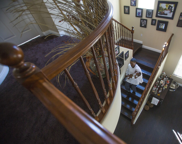 Deon Derrico carries six month old Deniko down the steps of their home in North Las Vegas on Monday, March 24, 2014. Deon Derrico's wife had quintuplets on Sept. 6.(Jeff Scheid/Las Vegas Review-Jo ...