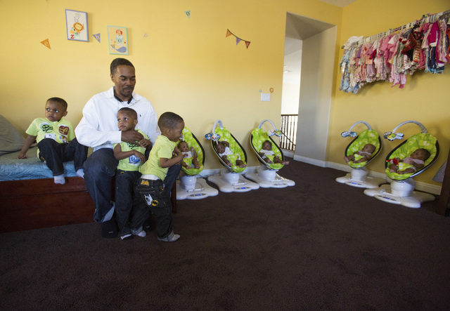 Deon Derrico with eight of his nine children at their home in North Las Vegas on Monday, March 24, 2014. His wife Evonne Derrico gave birth to quintuplets on Sept. 6.(Jeff Scheid/Las Vegas Review- ...