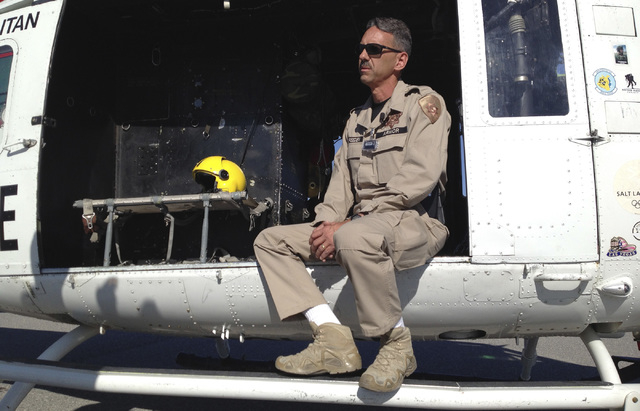 Las Vegas police Detective Rick Breeden sits in the helicopter for Las Vegas Metro police after it arrived for a radiation detection exercise on Tuesday at Desert Rock Airport, 65 miles northwest  ...