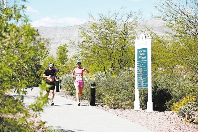 Courtesy photo Providence residents jog on one of the North Las Vegas master-planned community's trails.