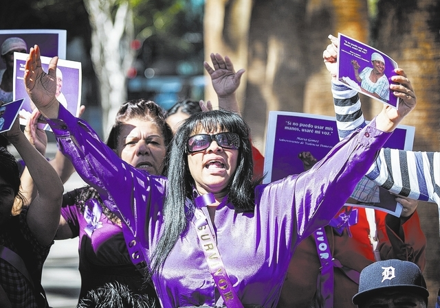 Rebeca Ferreira, an advocate for domestic abuse victims, demonstrate with other victims outside Clark County District Court on Monday, Feb. 24, 2014. Around 15 people rally in demanding justice on ...