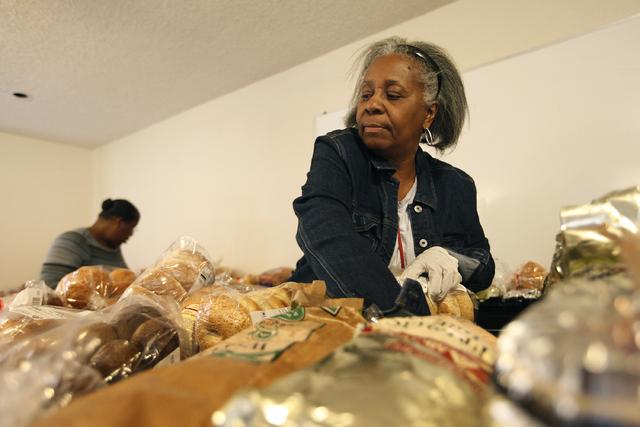 Mattie Parks hands out bread at the Macedonia Outreach Social Enrichment Services food pantry on North Las Vegas Thursday, Feb. 27, 2014. (John Locher/Las Vegas Review-Journal)