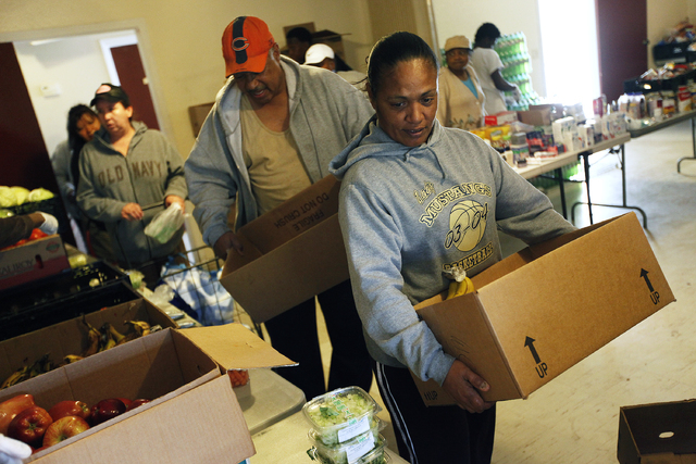 """Rosa Hayes, right, and Robert Hayes receive food at the Macedonia Outreach Social Enrichment Services food pantry on North Las Vegas Thursday, Feb. 27, 2014. """"Without kitchens like this, we w ..."""