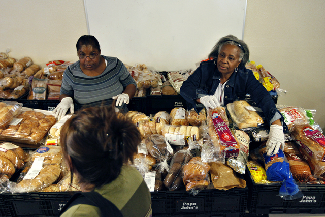 Mattie Parks, right, and Dorthy Pickins hand out bread at the Macedonia Outreach Social Enrichment Services food pantry on North Las Vegas Thursday, Feb. 27, 2014. (John Locher/Las Vegas Review-Jo ...