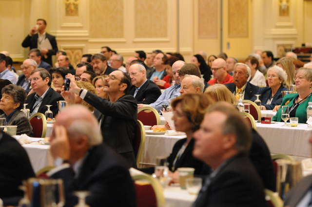 Attendees listen to John Bolton, former U.S. Ambassador to the United Nations, speak during the Republican Jewish Coalition's annual conference at the Venetian casino-hotel in Las Vegas Saturday,  ...