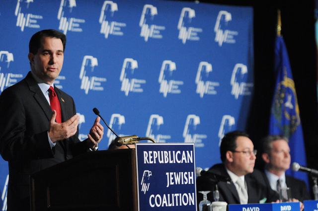 Wisconsin Gov. Scott Walker, left, speaks during the Republican Jewish Coalition's annual conference at the Venetian casino-hotel in Las Vegas Saturday, March 29, 2014. (Erik Verduzco/Las Vegas Re ...
