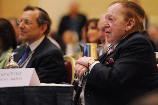 Sheldon Adelson, right, CEO at Las Vegas Sands Corp., listens to New Jersey Gov. Chris Christie during the Republican Jewish Coalition's annual conference at the Venetian casino-hotel in Las Vegas ...