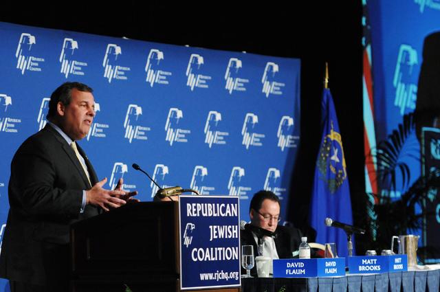 New Jersey Gov. Chris Christie, left, speaks during the Republican Jewish Coalition's annual conference at the Venetian casino-hotel in Las Vegas Saturday, March 29, 2014. (Erik Verduzco/Las Vegas ...