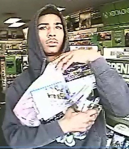 Las Vegas police, investigating a March 6 robbery at a business near Tropicana Avenue and McLeod Drive, are looking for a pair of suspects who wore hooded sweatshirts. The suspect shown here pulle ...