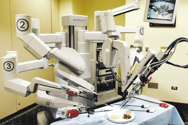 FILE - This Friday, June 13, 2008 file photo shows the da Vinci Surgical Robot at a hospital in Pittsburgh. Pricey robotic surgery shouldn't be the first or even second choice for most women who n ...