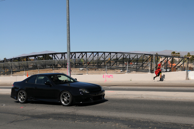 Traffic moves along over the Las Vegas Wash bridge on East Sahara Avenue near the Desert Rose Golf Course in Las Vegas Tuesday, March 11, 2014. Clark County is demolishing and lengthening the vehi ...