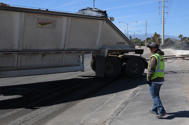 Michelle Wilson, flagger with the Las Vegas Paving Corp., monitors traffic at the Las Vegas Wash bridge on East Sahara Avenue near the Desert Rose Golf Course in Las Vegas Tuesday, March 11, 2014. ...