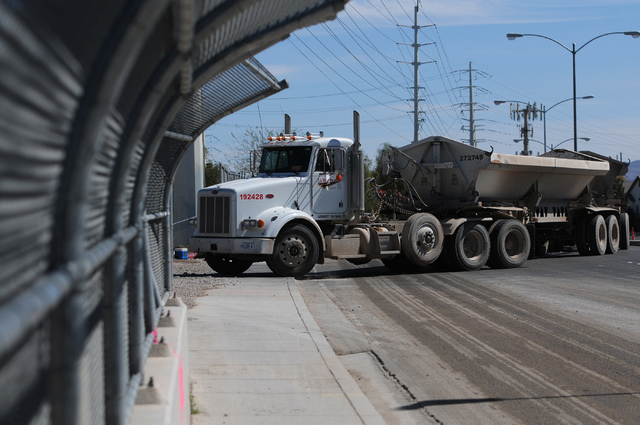 A truck enters the construction site at the Las Vegas Wash on East Sahara Avenue near the Desert Rose Golf Course in Las Vegas Tuesday, March 11, 2014. Clark County is demolishing and lengthening  ...