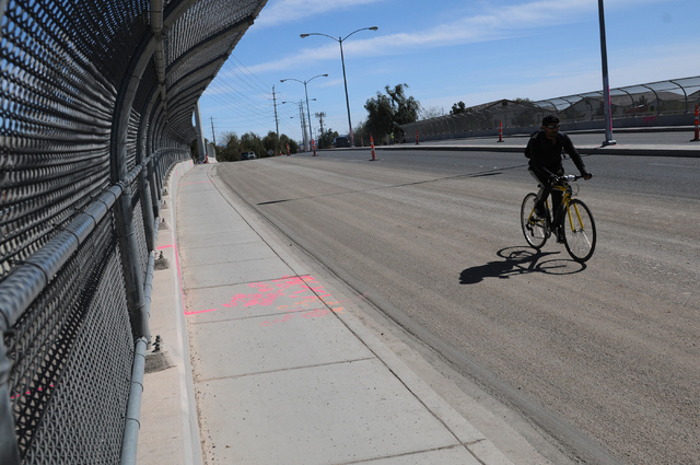 A bicyclist rides on the bridge over the Las Vegas Wash on East Sahara Avenue near the Desert Rose Golf Course in Las Vegas Tuesday, March 11, 2014. Clark County is demolishing and lengthening the ...