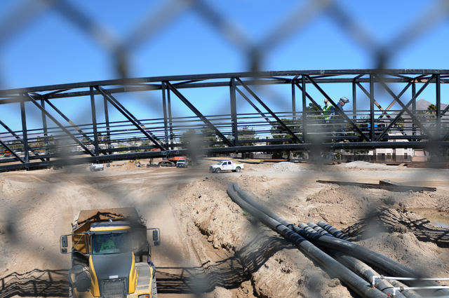 Construction workers build a pedestrian bridge as part of the Las Vegas Wash project on East Sahara Avenue near the Desert Rose Golf Course in Las Vegas Tuesday, March 11, 2014. Clark County is de ...