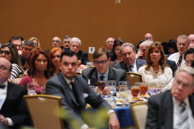 Attendees listen to keynote speaker Gov. Brian Sandoval  during the Nevada Taxpayer Association's 92nd annual luncheon at the Orleans casino-hotel in Las Vegas Tuesday, March 4, 2014. (Erik Verduz ...