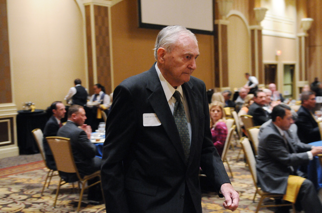 John McCandless walks to the stage to receive the Free Enterprise Award during the Nevada Taxpayer Association's 92nd annual luncheon at the Orleans casino-hotel in Las Vegas Tuesday, March 4, 201 ...