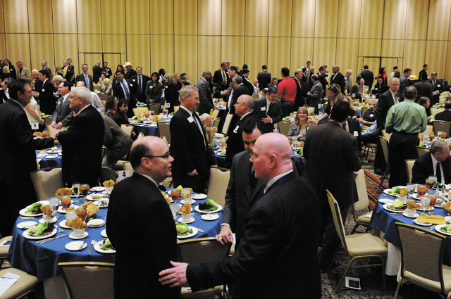 Attendees mingle during the Nevada Taxpayer Association's 92nd annual luncheon at the Orleans casino-hotel in Las Vegas Tuesday, March 4, 2014. (Erik Verduzco/Las Vegas Review-Journal)