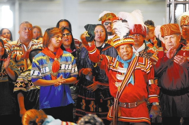THURSDAY FEBRUARY 2, 2012 COCONUT CREEK, FL - Members of the Seminole Tribe wave to the audience during the grand opening ceremony for the expansion to the Seminole Casino Coconut Creek, in Coconu ...