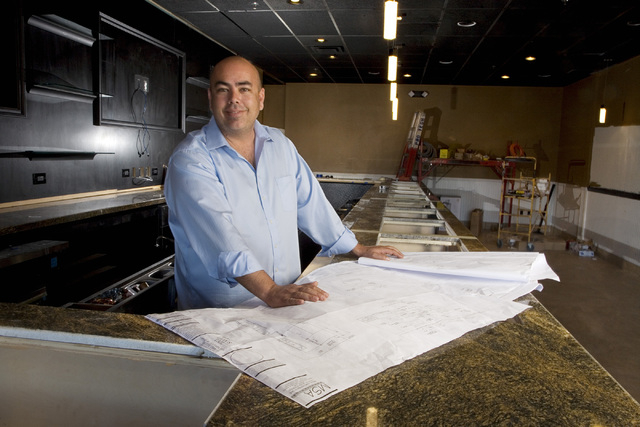 Ted Mamola, owner of Embers at Boca Park and The Lion's Tail Tavern at Village Square, stands inside the tavern as it was under construction on Jan. 16. The Lion's Tail Tavern was scheduled to ...