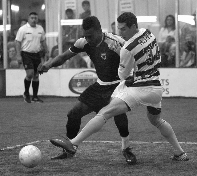 Las Vegas' Franck Tayou (15) battles San Diego's Jeff Hughes for the ball during their Professional Arena Soccer League quarterfinal game at the Las Vegas Sports Park on March 1, 2014. (Jason Bean ...