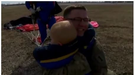 Specialist Ted Trece surprised his sons with his nine-month deployment by parachuting out of a plane down to where they were playing. (Credit: Screengrab, KTRK-TV)