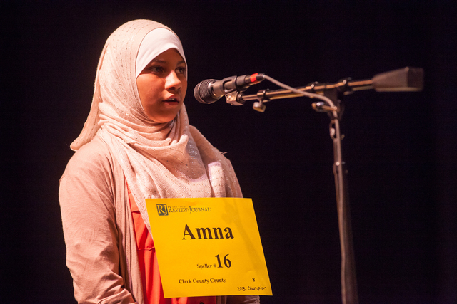 "Thirteen-year-old and 2013 champion Amna Raza of Clark County competes in the second round of the Nevada State Spelling Bee with the word ""herbivore"" at the Summerlin Library theater in  ..."