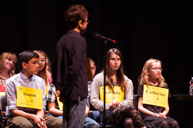 Fourteen-year-old Daniel Angres of Washoe County introduces himself before competing in the Nevada State Spelling Bee at the Summerlin Library theater in Las Vegas on Saturday, March 1, 2014. (Cha ...