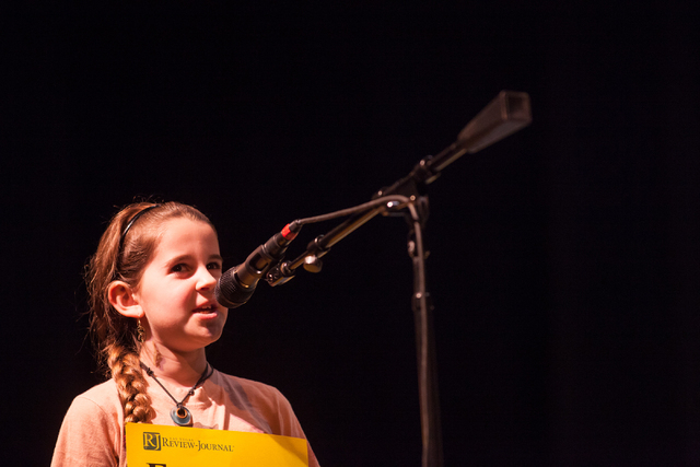 Twelve-year-old Emmaline Sorenson of White Pine County competes in the second round of the Nevada State Spelling Bee at the Summerlin Library theater in Las Vegas on Saturday, March 1, 2014. (Chas ...