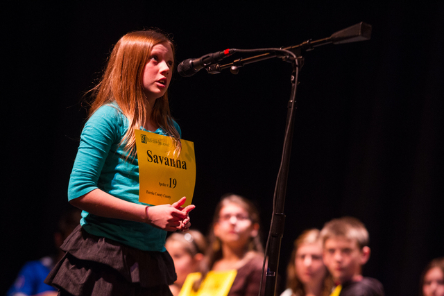 Twelve-year-old Savanna Sanders of Eureka County competes in the fourth round of the Nevada State Spelling Bee at the Summerlin Library theater in Las Vegas on Saturday, March 1, 2014. Raza won th ...