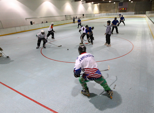 Roller hockey teams play during the Tuesday Night Adult League at the Southern Nevada Sports Centre, 3585 W. Diablo Drive, in Las Vegas on March 25. (Chase Stevens/Las Vegas Review-Journal)