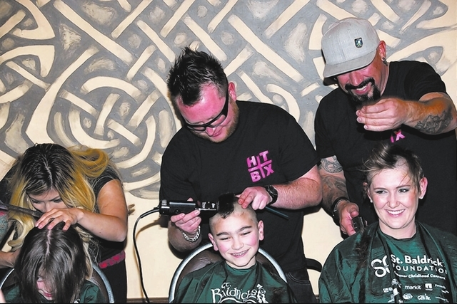 Students from the Sheldon Educational Campus, 9700 Hillpointe Road, get their heads shaved March 1 at McMullan's Irish Pub, 4650 W. Tropicana Ave., during a St. Baldrick's Foundation fundraise ...