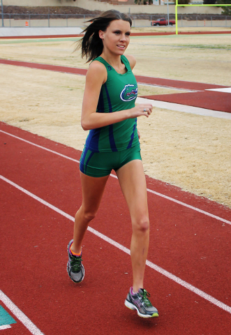 Stacie Hall, a senior at Green Valley High School, practices running on her school's track field in Henderson on Dec. 18, 2013. (Austin Connell/R-Jeneration)