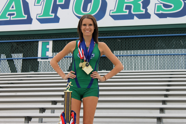 Stacie Hall, a senior at Green Valley High School, poses for a portrait with some of her awards at her school's track field in Henderson on Dec. 18, 2013. (Austin Connell/R-Jeneration)