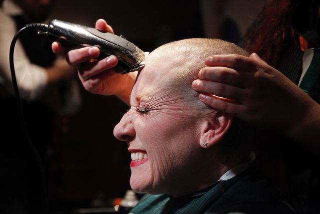 LeAnne Notabartolo reacts as she has her head shaved at Ri Ra Irish Pub at Mandalay Bay in Las Vegas Saturday, March 1, 2014. People shaved their head at the pub to help raise money for the St. Ba ...