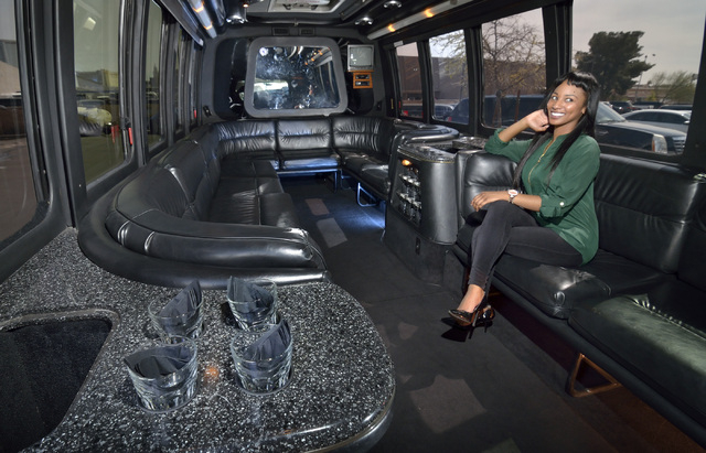 Latoya Rowell, executive assistant at AWG Ambassador limousine service, is shown in a 16-passenger limo coach. She said the limo coaches are hot products that often are booked well in advance. (Bi ...