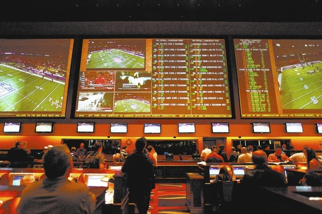 Prop bets are displayed above the crowd before the start of Super Bowl in the sports book at Red Rock Resort in Las Vegas on Sunday, Feb. 3, 2013. (Chase Stevens/Las Vegas Review-Journal)
