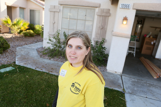Denzila Watts stands outside her future home, March 1. She works full time to support her daughters, ages 8, 10 and 13, and said she stumbled upon Habitat for Humanity's first-time homebuyer progr ...