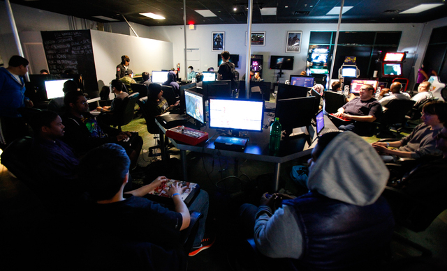 Gamers compete against one another in various fighting-based video games Feb. 20 during the Bloodsport 4 event, which takes place every other week at Press Start Gaming, 4840 S. Fort Apache Road,  ...