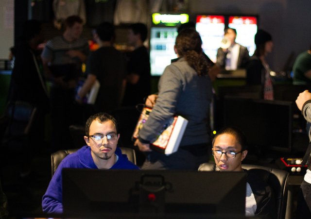Javier Morales, left, and Bryan Lubay compete in fighting-based video games during the Bloodsport 4 event Feb. 20 at Press Start Gaming. (Chase Stevens/View)