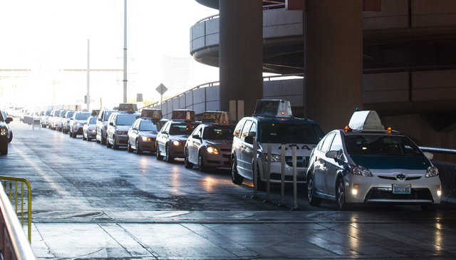Taxicabs wait in line at Terminal 1 at McCarran International Airport. Long hauling passengers by taxi drivers could be a problem in Las Vegas' efforts to lure the 2016 Republican National Convent ...