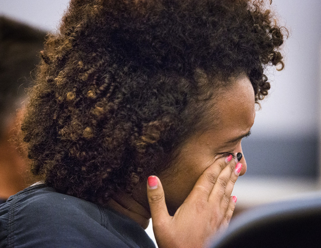 Tanikka Queen wipes a tear during hearing Friday in Las Vegas Justice Court. The substitute teacher was arrested Wednesday and charged with multiple counts for having sex with a 15-year-old studen ...
