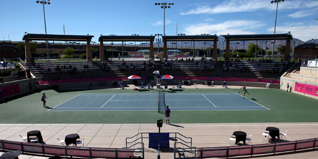 Melanie Oudin, left, faces off against CoCo Vandeweghe in the finals of the Party Rock Open tennis tournament at Darling Tennis Center in Las Vegas Sunday, Sep. 29, 2013. Oudin defeated Vandeweghe ...