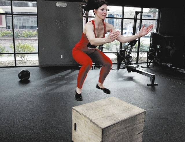 Trainer Laura Salcedo demonstrates the middle position for the box jump exercise at Mountain's Edge CrossFit in Las Vegas on Wednesday, February 12, 2014.(Justin Yurkanin/Las Vegas Review-Journal)