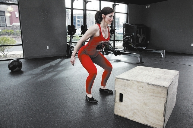 Trainer Laura Salcedo demonstrates the starting position for the box jump exercise at Mountain's Edge CrossFit in Las Vegas on Wednesday, February 12, 2014.(Justin Yurkanin/Las Vegas Review-Journal)