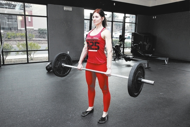 Trainer Laura Salcedo demonstrates the finishing position for the dead lift exercise at Mountain's Edge CrossFit in Las Vegas on Wednesday, February 12, 2014.(Justin Yurkanin/Las Vegas Review-Journal)