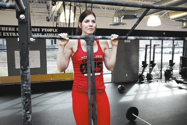 Trainer Laura Salcedo demonstrates the staring position for the internal rotation pull-up exercise at Mountain's Edge CrossFit in Las Vegas on Wednesday, February 12, 2014.(Justin Yurkanin/Las Veg ...