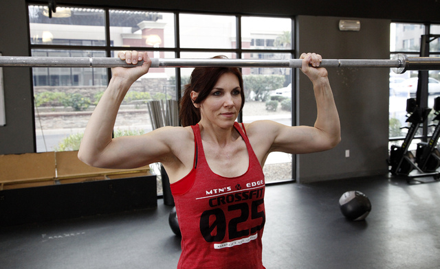 Trainer Laura Salcedo demonstrates the wrong form for the internal rotation press exercise at Mountain's Edge CrossFit in Las Vegas on Wednesday, February 12, 2014.(Justin Yurkanin/Las Vegas Revie ...