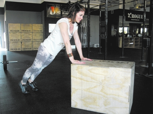 Third position for a simplified burpee with Laura Salcedo at Cross Fit Mountain's Edge on Wednesday March 19, 2014. (Michael Quine/Las Vegas Review-Journal)
